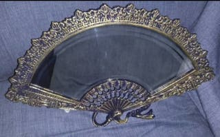 Abanico de bronce.Con espejo