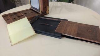 Antigua máquina fotografía madera y fuelle 1900