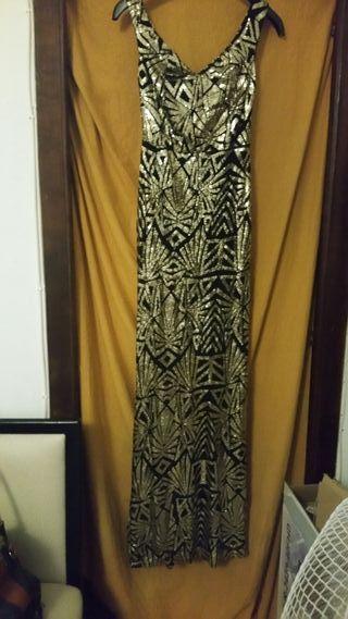 vestido de fiesta largo.fondo negro y dorado