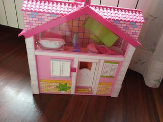 Casa de barriguitas y muñecas
