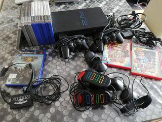 Playstation 2, con 2 mandos y juegos