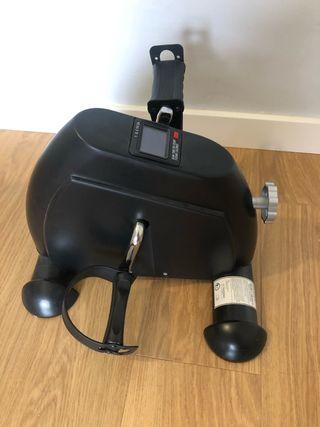 Mini bicicleta estática pedales sofa