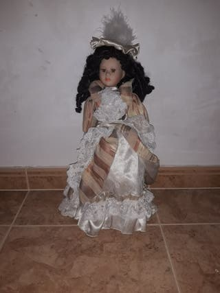 Muñeca porcelana como nueva