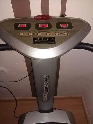 máquina vibratoria con libro de instrucciones.
