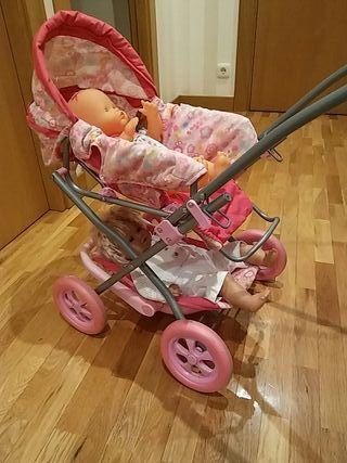 carrito de juguete con 2 muñecos