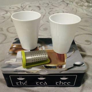 caja de te y 2 tazas nuevas