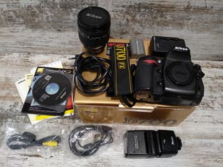 Nikon D700 + 24 -120 mm + Flash + 32 GB CF
