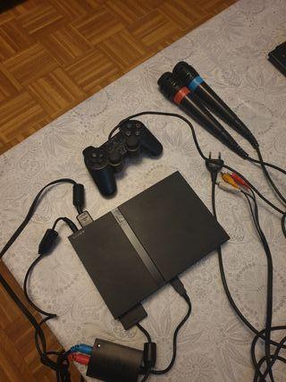 play station 2 ,con mando y 2 micrófonos