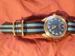Reloj marca Oris de cuerda. Revisado y en perfect