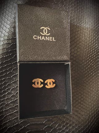 chanel earrings, chanel purse and gucci wallet