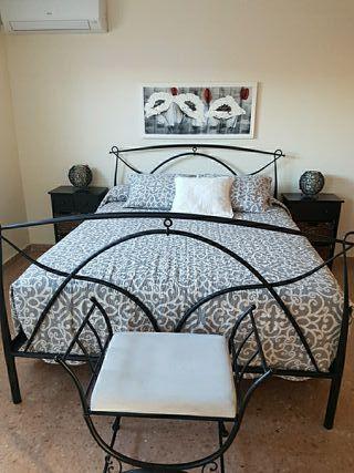 Conjunto dormitorio de forja.