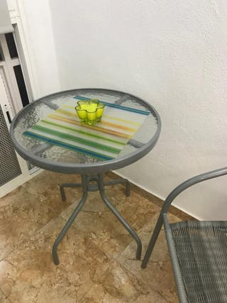 conjunto mesa y sillón de exterior