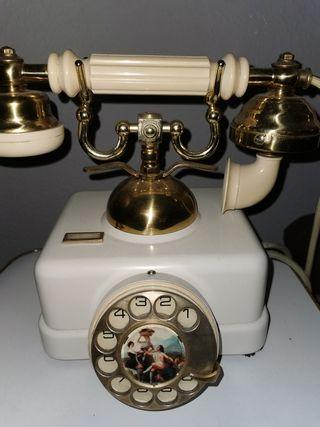 antiguo teléfono baquelita blanca