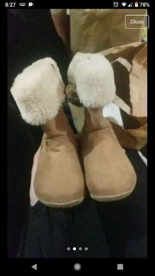 beautiful tan and white faux fur boots