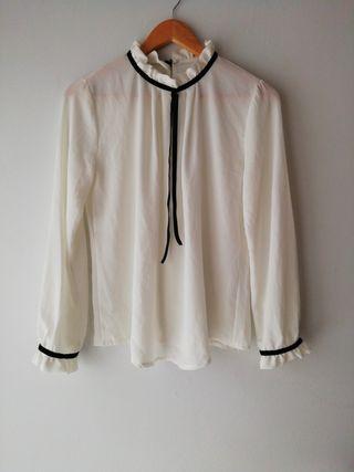 blusa blanca y negra