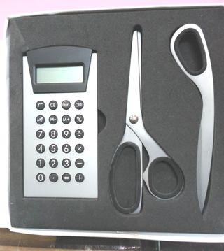 calculadora, tijeras,abrecartas