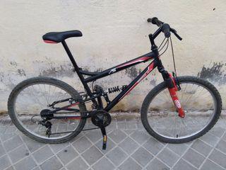 Bicicleta de montaña seminueva. Doble suspensión