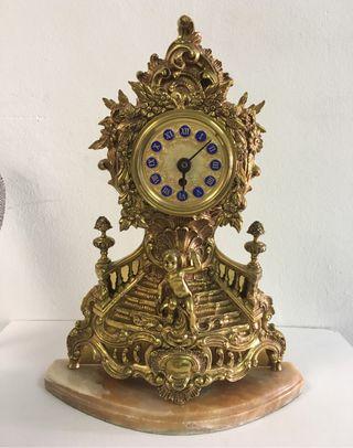 Reloj antiguo de bronce y