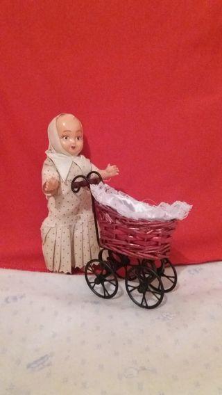 Muñequita y carrito de bebe