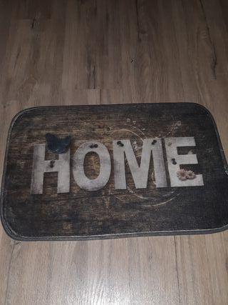 Alfombra bienvenida puerta casa
