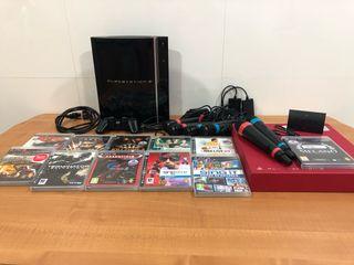 Playstation 3 con juegos y micrófonos