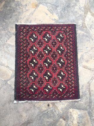 Alfombra oriental antigua