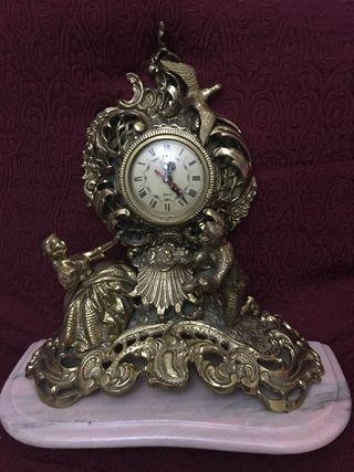 Impresionante reloj antiguo de bronce
