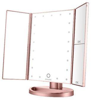 Espejo de maquillaje de tres aumentos