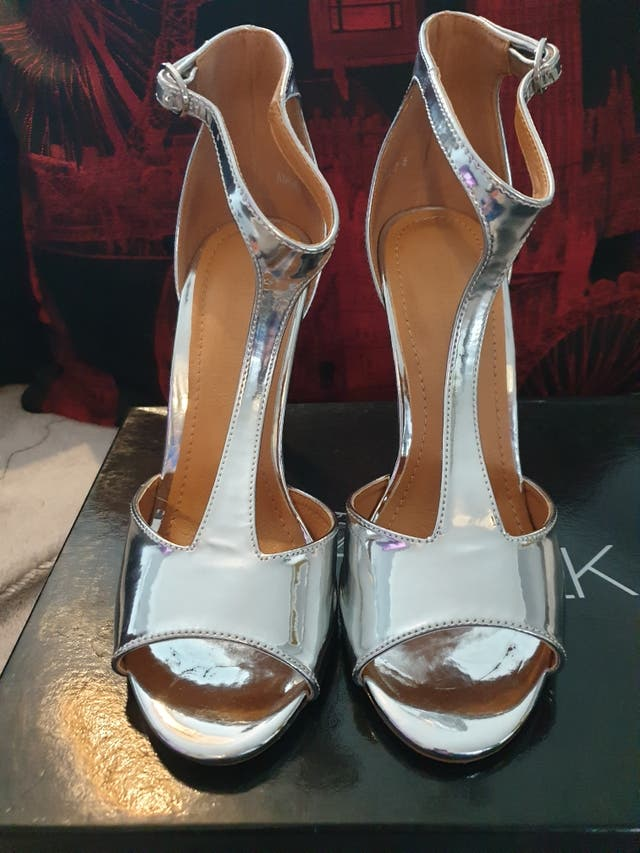 New silver T bar heels. size 5.