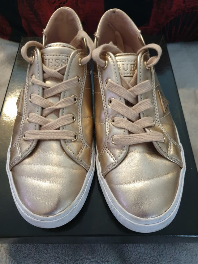 Guess gold leather embroidered trainers. Size 5.5