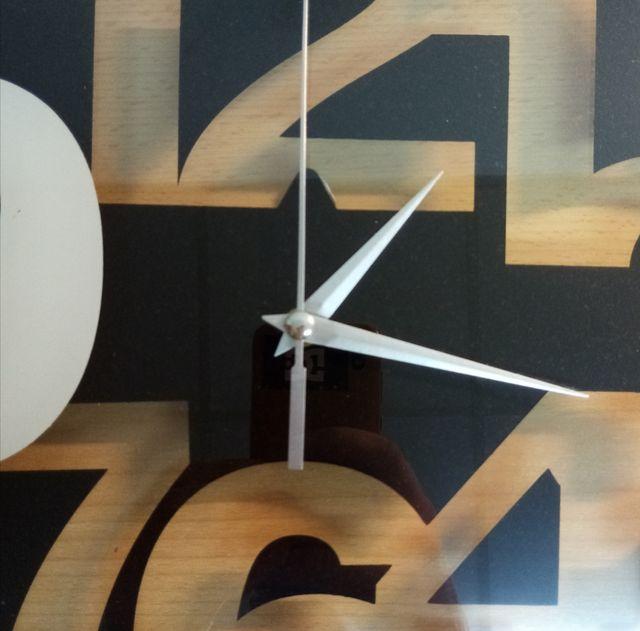 Reloj de cristal moderno 30x30