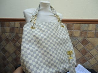 bolso louis vuitton , mide de ancho 44 cm, alto 33