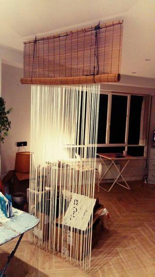 estore de bambu y cortina flecos