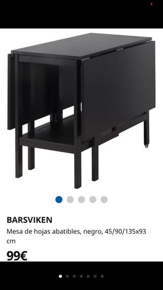 Mesa extensible Ikea negra.