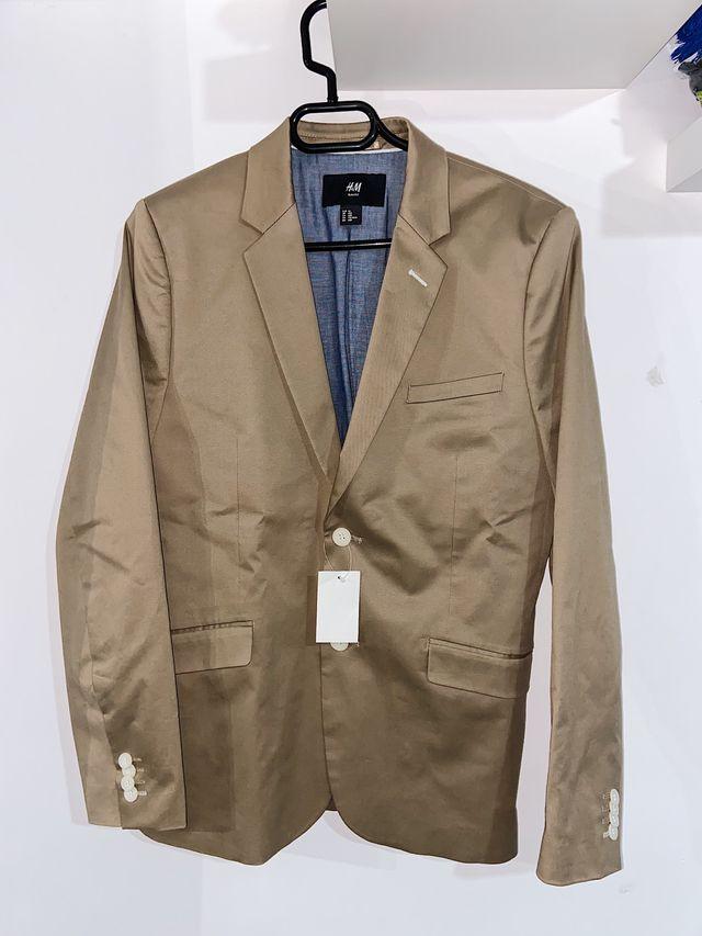 Americana color marrón talla M.