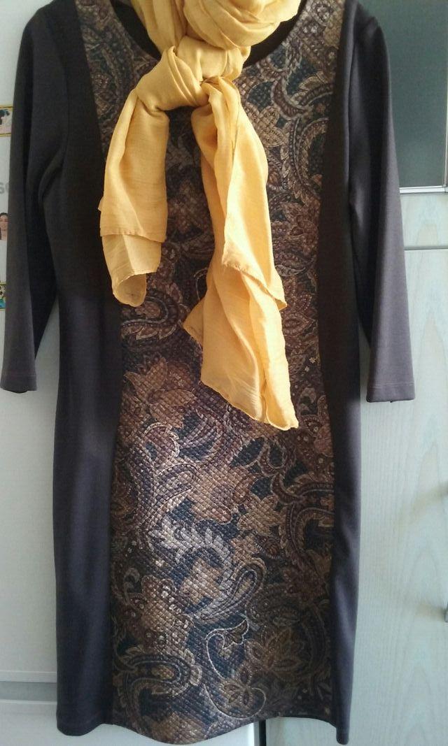 Sin estrenar.vestido marron
