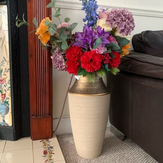 Ceramic vase with very real plastic flowers