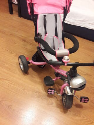 Triciclo rosa de 12 a 36 meses.