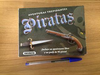 Pequeña caja con libro y puzzle de Piratas