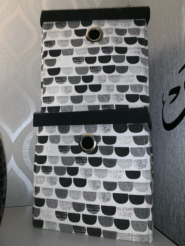 Black and white storage boxes with lids