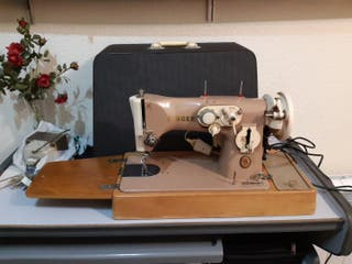 Máquina de coser Singer portatil