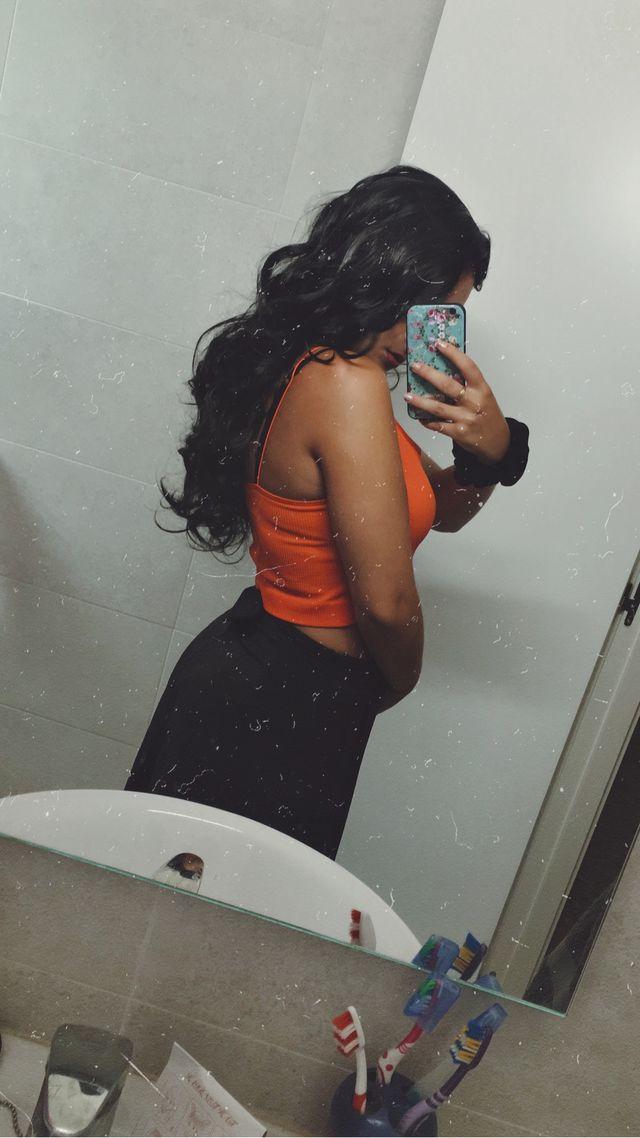 Peluca larga ondulada de pelo negro