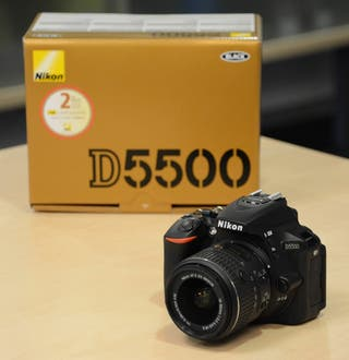 Nikon D5500 dSLR with 18-55mm kit lens + extras