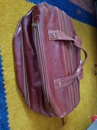 maleta cuero
