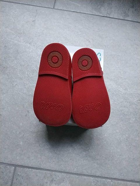 Zapatitos rojos.