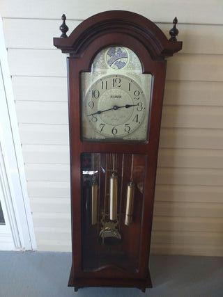 Reloj con pendulos