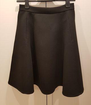 Falda cintura alta. U Adolfo Domínguez.