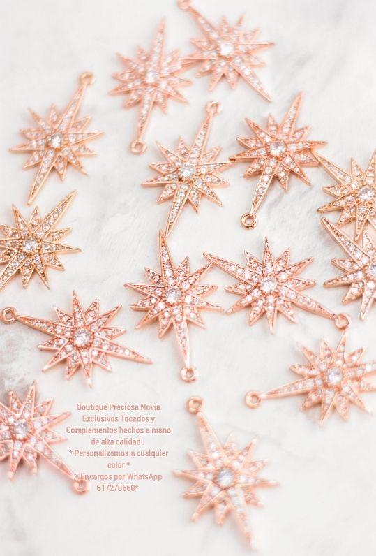 Pendientes en forma estrella en tono oro rosa