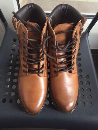Boots compensées en cuir Eram