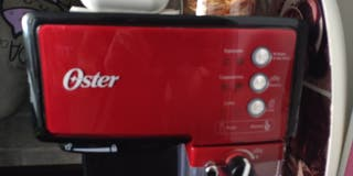 Cafetera Oster prima late.